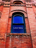 Lawyer Sign on Window — Stock Photo