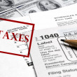 Stock Photo: Tax Forms on top of Money