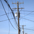 Power Lines and Poles in Town — Stock Photo #38989599