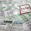 Tax Forms on top of Money — Stockfoto