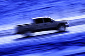 Driving a Speedy Truck — Stock Photo