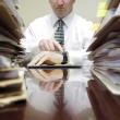 Businessman at Desk with Files Pointing at Watch — Stok fotoğraf