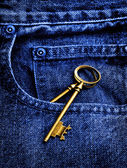 Jeans with Old Key in Pocket — Stock Photo