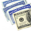 Social Security Cards and Cash Money — Stock Photo
