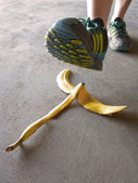 Detail of Person Stepping on Banana Peel and Slipping — Stock Photo
