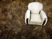 Old Worn Chair Abandoned in Grass Weeds — Stock Photo