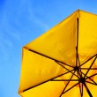 Yellow Umbrella and Blue Sky — Stock Photo #42906327