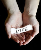Hands Holding Paper Message Love — Stock fotografie