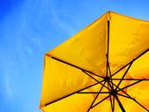 Yellow Umbrella and Blue Sky — Stock Photo