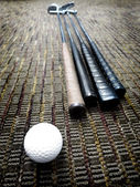 Golf Clubs and Ball in Office on Carpet — Stock Photo
