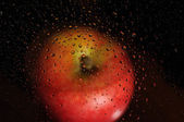Apple and water drops — Stock Photo