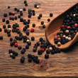 Peppercorn on the desk — Stock Photo #21459901
