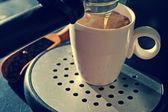Espresso from coffee machine — Stock Photo