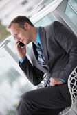 Businessman talking on a mobile phone — Stock Photo
