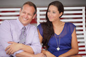Couple sitting and smiling — Stock Photo