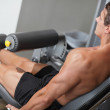Bodybuilder lifting weights - Stock Photo