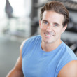Man smiling in the gym - Stock Photo