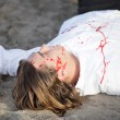 Stock Photo: Dead body on beach