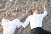 Couple murdered on the beach — Stock Photo