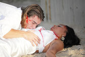 Man laying over his murdered wife — Stock Photo