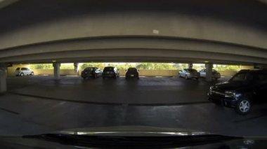 Car driving through a parking garage — Stock Video