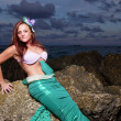Mermaid posing on the rocks — Stock Photo