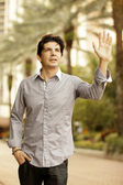 Man waving with underarm perspiration — Stock Photo