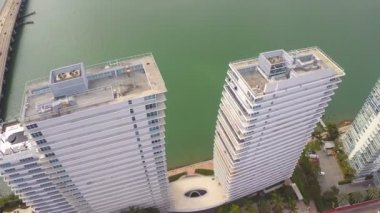Aerial flyover of waterfront buildings — Stock Video
