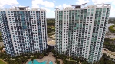Aerial highrise condos on the lake — Stock Video