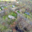 Aerial video of houses in the woods — Stock Video