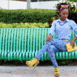 Stock image fashion model sitting on a bench — Stock Photo #47102361