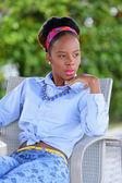 Stock image retro fashion woman sitting and glancing away — Stock Photo