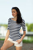 Attractive young woman in a striped shirt — Stock Photo
