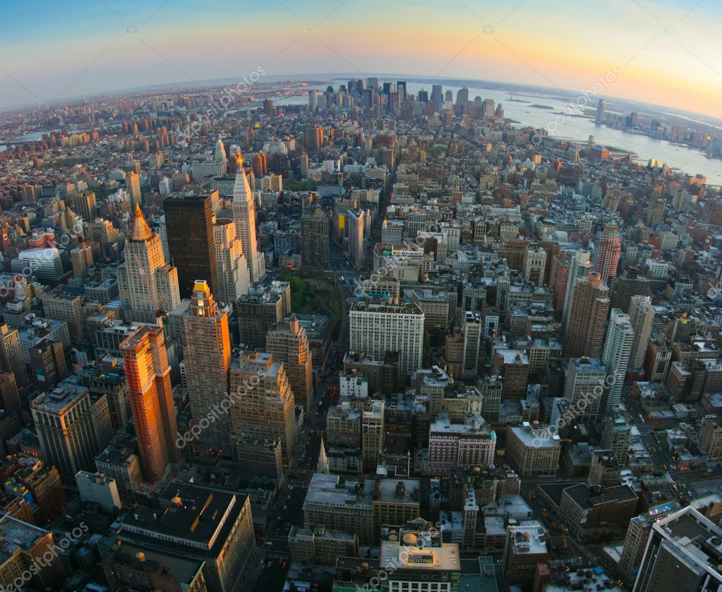 Aerial panoramic fisheye view over lower Manhattan, New York from Empire State building top at sunset — Stock Photo #18578183