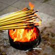 Stock Photo: Lighting incense sticks