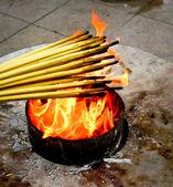 Lighting incense sticks — Stock Photo