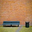 Stock Photo: Bench and Brick Wall