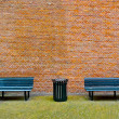 Royalty-Free Stock Photo: Bench and Brick Wall
