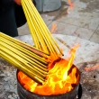 Prayers Lighting Incense Sticks - Stock Photo