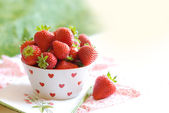 Cup with strawberries — Stock Photo