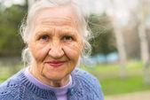 Portrait smiling elderly woman — Stock Photo