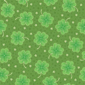 Green seamless background with shamrock — Stock Vector