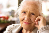 Thinking elderly woman — Stock Photo