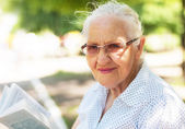 Elderly woman with book — Stock Photo