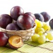 Fresh plums and grapes — Stock Photo