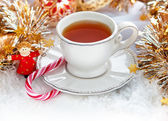 Christmas tea cup — Stock Photo
