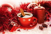 Red Christmas tea cup — Stock Photo