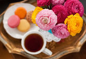 Teacup with flowers — Stock Photo