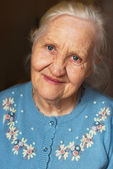 Smiling elderly woman — Stock Photo