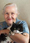 Elderly woman with cat — Stock Photo